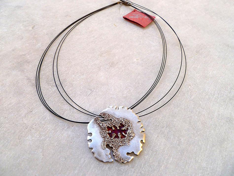 Silver pendant with enamel