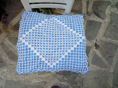 White hand-crochet cushion