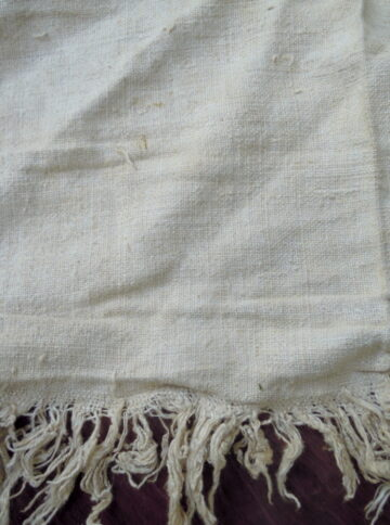 Old handwoven cloth in ocher