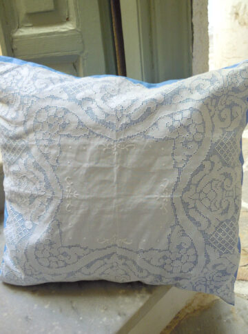 Hand-embroidered cushion with cutwork