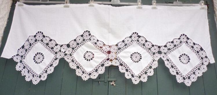 Old handmade curtain with crochet