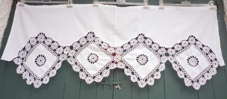 Old handmade curtain with crochet