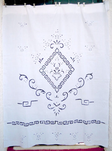 White traditional cutwork curtain