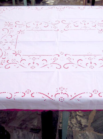 White handmade cutwork tablecloth