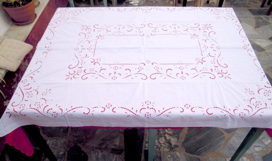 White handmade cutwork tablecloth