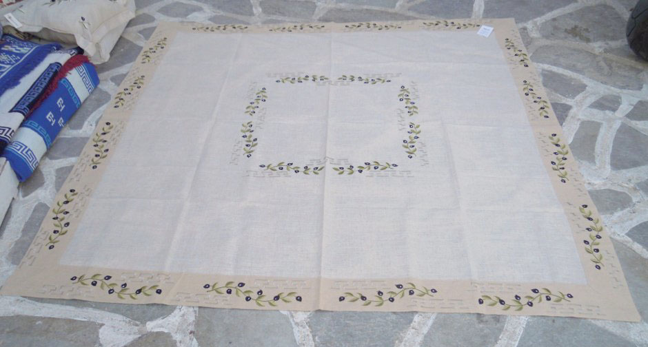 Beige tablecloth with satin stitch embroidery