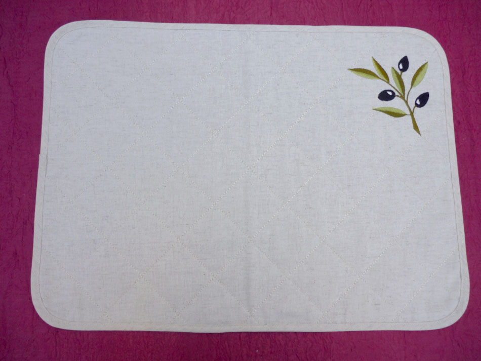 Quilted placemat with embroidery