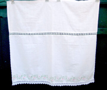 White handmade curtain with satin stitch