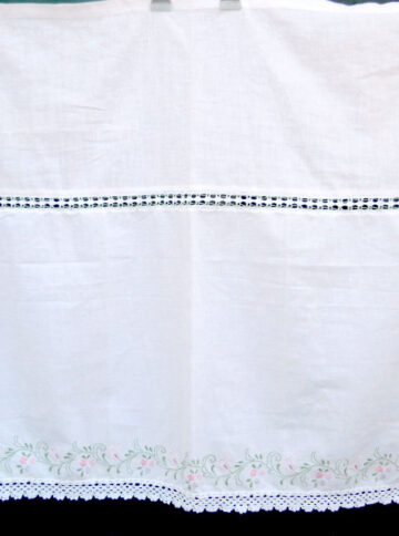 White handmade curtain with satin stitch