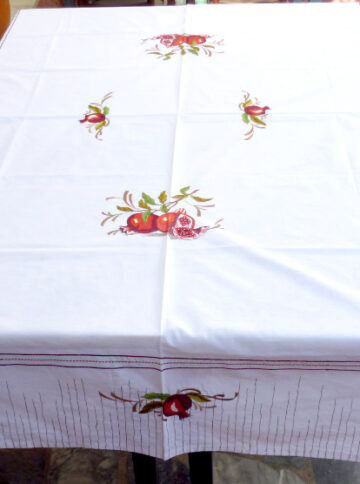 White tablecloth with satin stich
